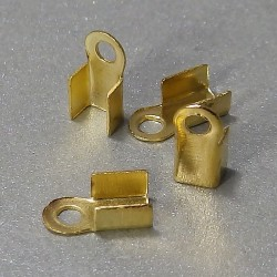 Koncovka na kožu zlatá